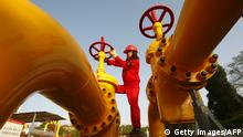 A Chinese worker checks the valve of a gas pipe at a natural gas plant in Suining, in southwest China's Sichuan province on November 15, 2010. China, the world's second largest economy and its number one energy consumer, is shaking up global commodities markets where its potent growth momentum is also powering a rise in metals prices. CHINA OUT AFP PHOTO (Photo credit should read STR/AFP/Getty Images)