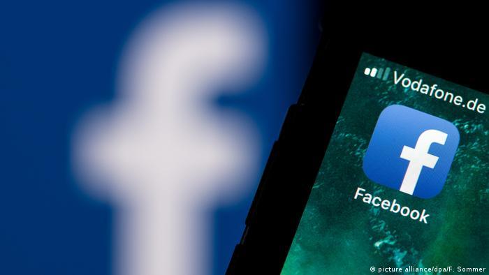 Facebook logo on a smartphone screen