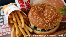 FILE- This Feb. 1, 2018, file photo shows a Burger King Whopper meal combo at a restaurant in the United States. Burger King says it's sorry for offering a lifetime supply of Whoppers to Russian women who get pregnant from World Cup players. (AP Photo/Gene J. Puskar, File) |