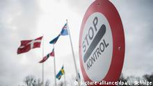 ARCHIV - 02.02.2016, Dänemark, Krusa: Ein Warnschild mit der Aufschrift «Stop - Kontrol» ist während einer Grenzkontrolle an der Grenze zu Krusa (Dänemark) vor den Flaggen von Island, Dänemark, Norwegen und Schweden zu sehen. Der katalanische Ex-Regionalpräsident Carles Puigdemont ist am Sonntagvormittag bei der Einreise von Dänemark nach Deutschland festgesetzt worden. (zu dpa Puigdemont bei Einreise nach Deutschland festgenommen vom 25.03.2018) Foto: Lukas Schulze/dpa +++(c) dpa - Bildfunk+++   Verwendung weltweit