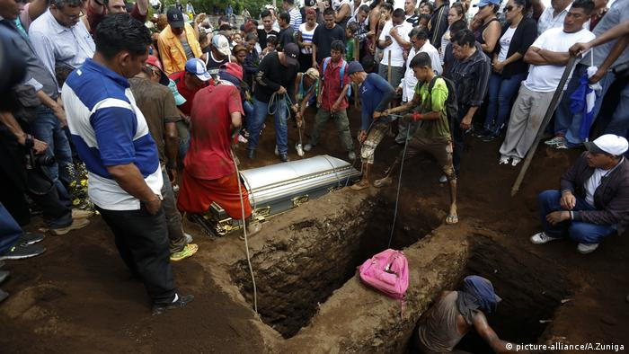 People gather at a funeral for 6 family members who died in Nicaragua's violence