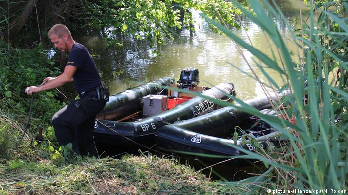 Police from Nuremberg search the river Pegnitz for the missing hitchhiker