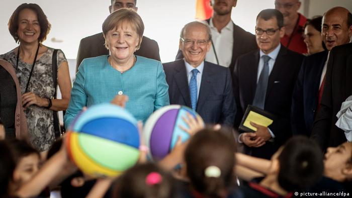 German Chancellor Angela Merkel at a school in Lebanon