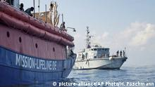 In this photo taken on Thursday, June 21, 2018, the ship operated by the German NGO Mission Lifeline is reached by a Libyan Coast Guard boat after they rescued migrants from a rubber boat in the Mediterranean Sea in front of the Libyan coast. Italy's interior minister says Malta should allow a Dutch-flagged rescue ship carrying 224 migrants to make port there because the ship is now in Maltese waters. Salvini said the rescue was in Libyan waters, which Lifeline denies. (Hermine Poschmann/Mission Lifeline via AP) |