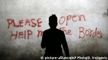 A migrant walks through an abandoned warehouse that has served as a make-shift shelter for hundreds of men trying to reach Western Europe, in Belgrade, Serbia, Tuesday, March 21, 2017. Thousands of migrants have been stranded in Serbia looking for ways to reach western Europe. Many have tried several times to cross to Hungary or Croatia. (AP Photo/Darko Vojinovic) |