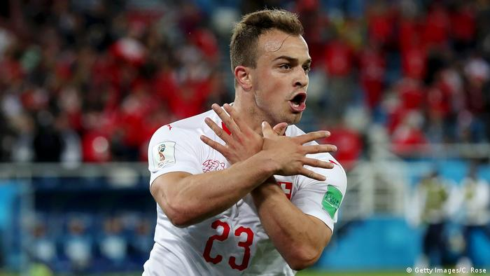 Swiss footballer Xherdan Shaqiri makes the Albanian double eagle gesture during a World Cup match against Serbia (Getty Images/C. Rose)