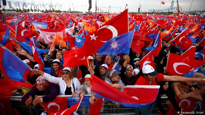Supporters of Turkish President Tayyip Erdogan react during an election rally in Istanbul (REUTERS)