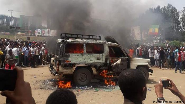 A car goes up in flames after a bomb blast in Addis Ababa, Ethiopia.