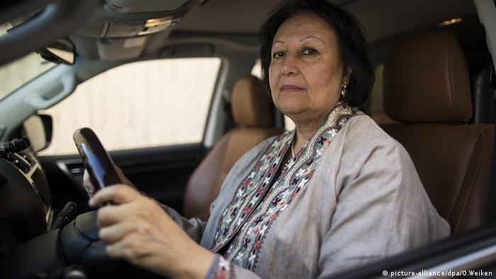 Madeha Alajroush sits behind the steering wheel of a car