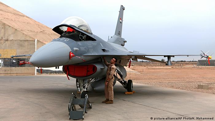 An Iraqi pilot checks a US-made Iraqi Air Force F-16 fighter jet at the Balad air base near Baghdad in February 2018