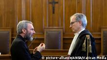 Monsignor Carlo Alberto Capella, left speaks with his lawyer Roberto Borgogno.