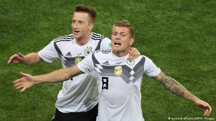 Toni Kroos and Marco Reus (picture-alliance/AP/Y. Pingan)