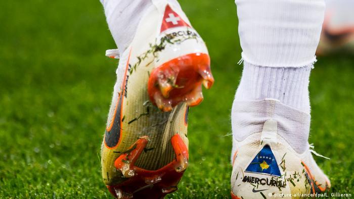 Xherdan Shaqiri's right shoe displays the flag of Kosovo