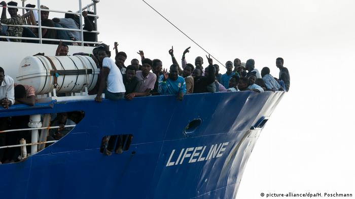 Migrants standing at the bows of the Lifeline