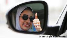 24.06.2018 *** Zuhoor Assiri gestures as she drives her car in Dhahran, Saudi Arabia, June 24, 2018. REUTERS/Hamad I Mohammed