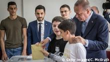 ISTANBUL, TURKEY - JUNE 24: Turkey's President Recep Tayyip Erdogan casts his vote with his grandsons in the countries parliamentary and presidential election on June 24, 2018 in Istanbul, Turkey. Voting opened across Turkey after weeks of campaigning. Turks are voting in a snap Parliamentary and Presidential election called by President Recep Tayyip Erdogan. (Photo by Chris McGrath/Getty Images)
