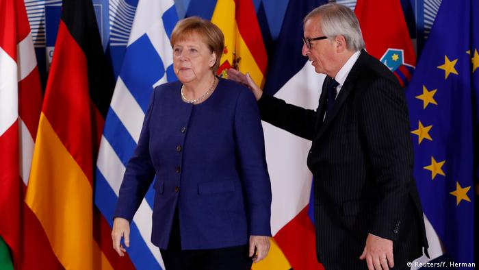 German Chancellor Angela Merkel welcomed by European Commission President Jean-Claude Juncker at the start of the Brussels meeting