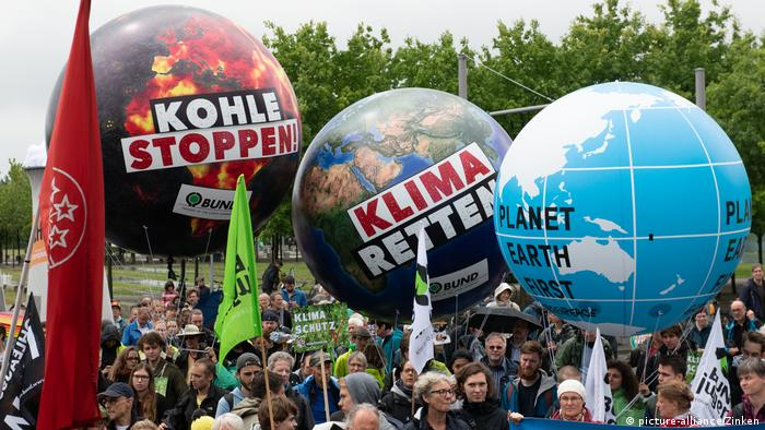 Protesters carry very large balloons with pro-environment slogans on them during an anti-coal demonstration in Berlin.