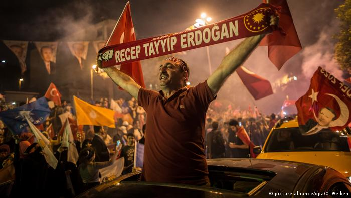 An Erdogan supporter celebrates as he claims victory in presidential elections, 24 June 2018