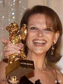 Italian movie star Claudia Cardinale poses after she was awarded withthe 'Golden Bear' honorary award for her lifetime achievement at the current 52nd Berlinale International Film Festival in Berlin on Friday, Feb. 15, 2002. (AP Photo/ Jan Bauer)