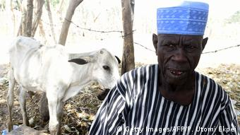 The leader of a cattle market in Benue state in northcentral Nigeria with a goat in the background