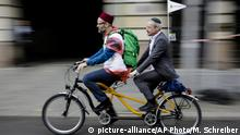 24.06.2018+++ A Muslim and a Jewish man rides a tandem together during a bicycle tandem tour of Jews and Moslems against anti-Semitism and hatred of Muslims in Berlin, Sunday, June 24, 2018. (AP Photo/Markus Schreiber)  