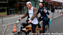 Imam and rabbi on tandem bike (Getty Images/AFP/J. MacDougall)