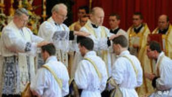 A group of male priests being ordained