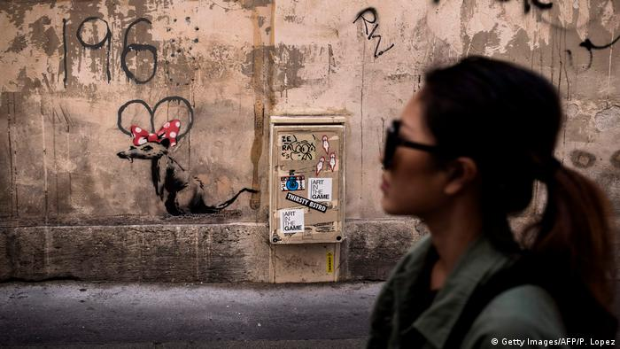 Banksy rat with Minnie Mouse ears