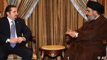 In this photo released by Hezbollah media office, Hezbollah leader Sheik Hassan Nasrallah, right, meets with Lebanese majority leader lawmaker Saad Hariri, left, in Beirut, Lebanon, late Thursday June 25, 2009. Lebanon's Hezbollah says the group's chief met with the leader of the Western-backed parliament majority in another step ahead of the expected formation of a unity government. Hariri is expected to be nominated for the post. (AP Photo/Hezbollah Media Office) ** EDITORIAL USE ONLY NO SALES **
