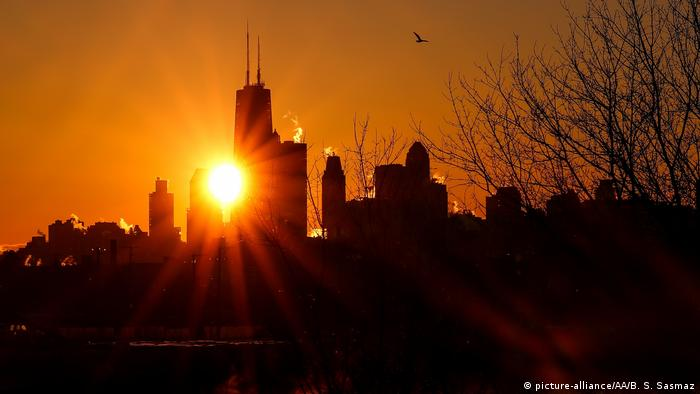 Smoke rises from the skyscrapers during sunrise as extremely cold weather reaching minus 20 in the nights hits Chicago