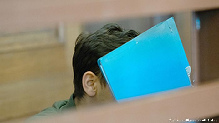 A 19-year-old man who confessed to striking two men wearing skullcaps in Berlin with a belt sits in court