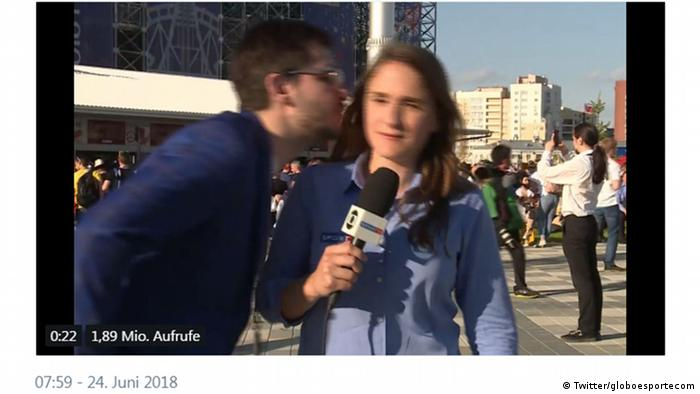 A screenshot shows a reporter dodging a kiss onscreen from a man (Twitter/globoesportecom)