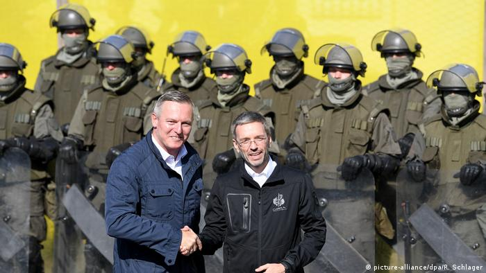 Austria's defense and interior ministers shake hands during the exercises