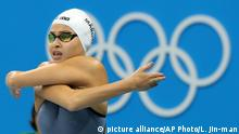 Yusra Mardini, swimming for the Refugee Olympic Team, prepares to compete in a heat of the women's 100-meter freestyle during the swimming competitions at the 2016 Summer Olympics, Wednesday, Aug. 10, 2016, in Rio de Janeiro, Brazil. (AP Photo/Lee Jin-man) |