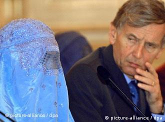 An Afghan woman wearing a burqa sits in a French parliament session in 2001