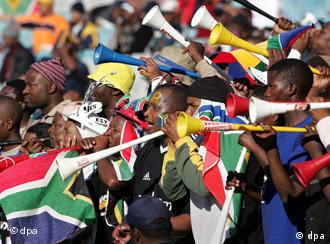 South African soccer fans with vuvuzelas