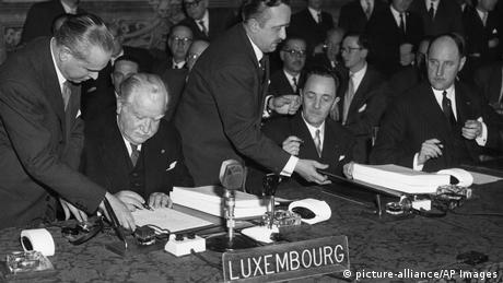 Foreign Minister of Luxembourg Joseph Bech, with pen, signs Euratom and Common Market Agreement, in Rome, Italy, on March 25, 1957. Next to him preparing to sign is Under-Secretary for Foreign Affairs for Luxembourg Albert Schaus and far right is Dutch Foreign Minister Joseph Luns (picture-alliance/AP Images)