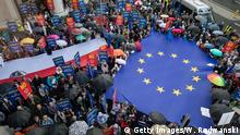 People deploy a giant European flag during a demonstration against Government plans of Judical system reforms on June 26, 2018 in front of the European Commission Representation office in Warsaw. (Photo by Wojtek RADWANSKI / AFP) (Photo credit should read WOJTEK RADWANSKI/AFP/Getty Images)