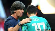 Soccer Football - World Cup - Group F - South Korea vs Germany - Kazan Arena, Kazan, Russia - June 27, 2018 Germany coach Joachim Low speaks with Mesut Ozil during the match REUTERS/Michael Dalder