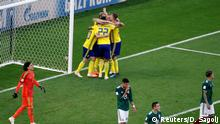 Soccer Football - World Cup - Group F - Mexico vs Sweden - Ekaterinburg Arena, Yekaterinburg, Russia - June 27, 2018 Sweden players celebrate after Mexico's Edson Alvarez scored an own goal and the third goal for Sweden REUTERS/Damir Sagolj