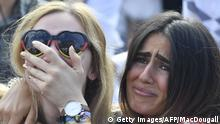 Supporters of the German national football team react as they attend a public viewing event at the Fanmeile in Berlin to watch the Russia 2018 World Cup Group F football match between South Korea and Germany on June 27, 2018. (Photo by John MACDOUGALL / AFP) (Photo credit should read JOHN MACDOUGALL/AFP/Getty Images)