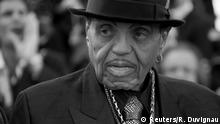 FILE PHOTO: Joe Jackson, father of the late pop star Michael Jackson, poses on the red carpet as he arrives for the screening of the film Sils Maria (Clouds of Sils Maria) in competition at the 67th Cannes Film Festival in Cannes, France, May 23, 2014. REUTERS/Regis Duvignau/File Photo