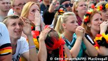 27.06.2018**** Supporters of the German national football team react as they attend a public viewing event at the Fanmeile in Berlin to watch the Russia 2018 World Cup Group F football match between South Korea and Germany on June 27, 2018. (Photo by John MACDOUGALL / AFP) (Photo credit should read JOHN MACDOUGALL/AFP/Getty Images)