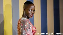 Ugandan-born German actress Florence Kasumba poses on arrival for the European Premiere of 'Black Panther' in central London on February 8, 2018. / AFP PHOTO / Tolga AKMEN (Photo credit should read TOLGA AKMEN/AFP/Getty Images)