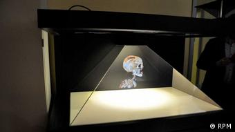 A mummy hologram floats in a clear pyramid structure
