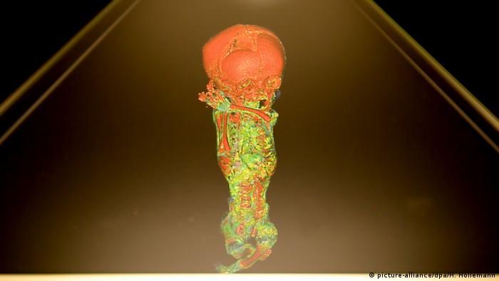 A hologram of a child mummy