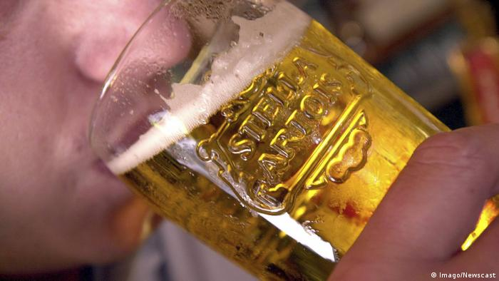 A man drinking Belgian beer.