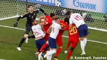 Soccer Football - World Cup - Group G - England vs Belgium - Kaliningrad Stadium, Kaliningrad, Russia - June 28, 2018 England's Gary Cahill in action while Belgium's Thibaut Courtois looks on REUTERS/Gonzalo Fuentes