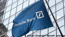 FILE - In this Friday, Oct. 7, 2016, file photo, a flag for Deutsche Bank flies outside the German bank's New York offices on Wall Street. Deutsche Bank, U.S. President Donald Trump's biggest lender, won't have to give up a part of its business as punishment stemming from a criminal conviction thanks to a temporary reprieve from the administration. (AP Photo/Mark Lennihan, File) |